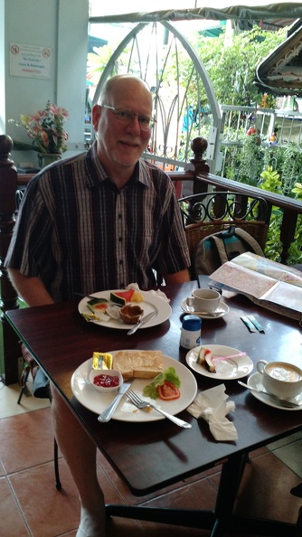 Guy breakfasting at our Bangkok guest house