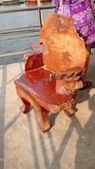 a live-edge wooden chair on a pier