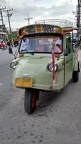 Front view of frog-faced tuk-tuk: