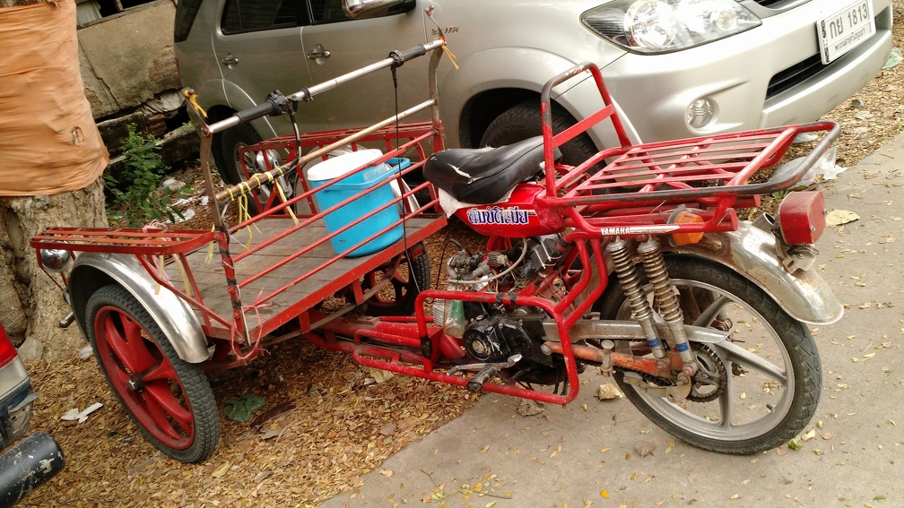 Motorized tricycle modified for loads in front